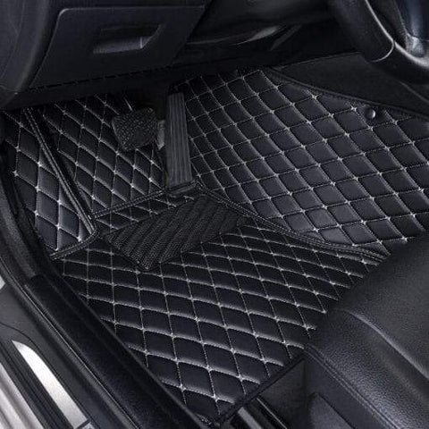 Car mats black leather with white stitching. Customized car mats.
