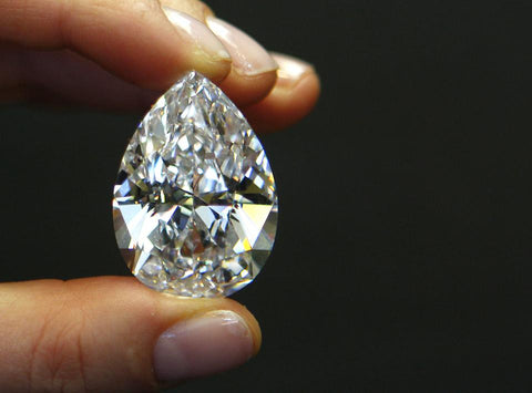 A 72.22 carat pear-shaped D-color diamond held during a media preview at Sotheby's in New York. Photographer: Andrew Harrer/Bloomberg News BLOOMBERG NEWS