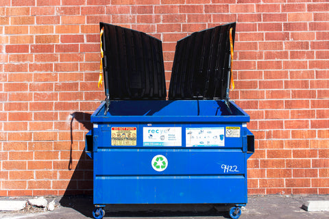 dumpster with both lids help open cleanly by kleen opener