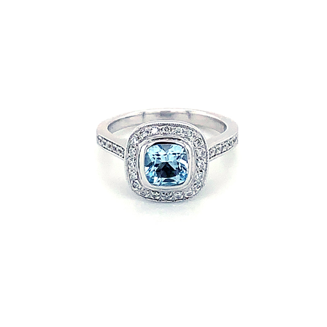 14K White Gold Sky Blue Topaz & Diamond Halo Ring