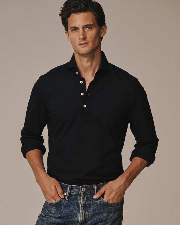 Model, Garrett Neff, wearing the Jonathan Mezibov navy Piqué Polo Shirt.