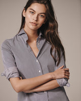 Close-up of a female model wearing the navy and white Pearson Striped Stretch Poplin Shirt.