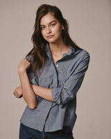 Female model wearing the Wingtip Chambray Shirt and jeans.