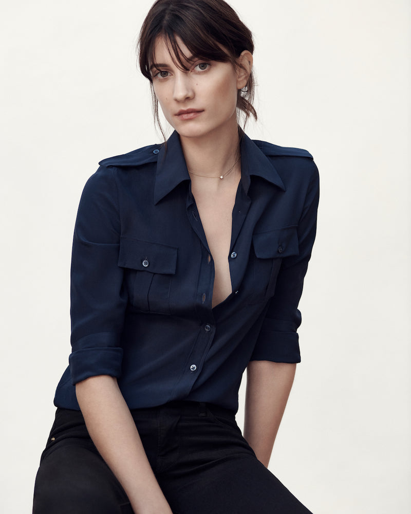 Female model wearing the Jonathan Mezibov navy Silk Crepe de Chine Military Shirt, made in Italy.