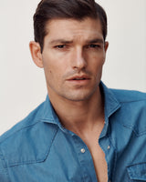 Close-up of male model wearing the Stone Washed Denim Western Shirt.