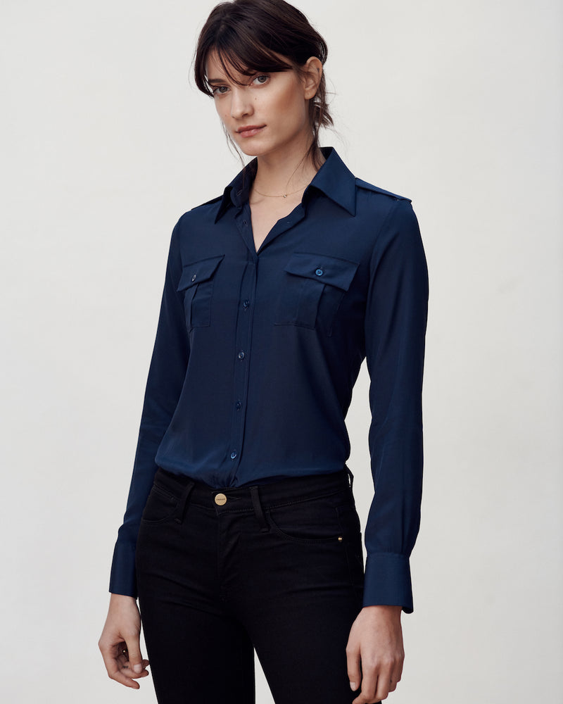 Female model wearing the Jonathan Mezibov navy Silk Crepe de Chine Military Shirt and jeans.