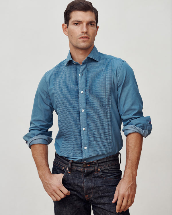 Male model wearing the Stone Washed Denim Tuxedo Shirt and jeans.