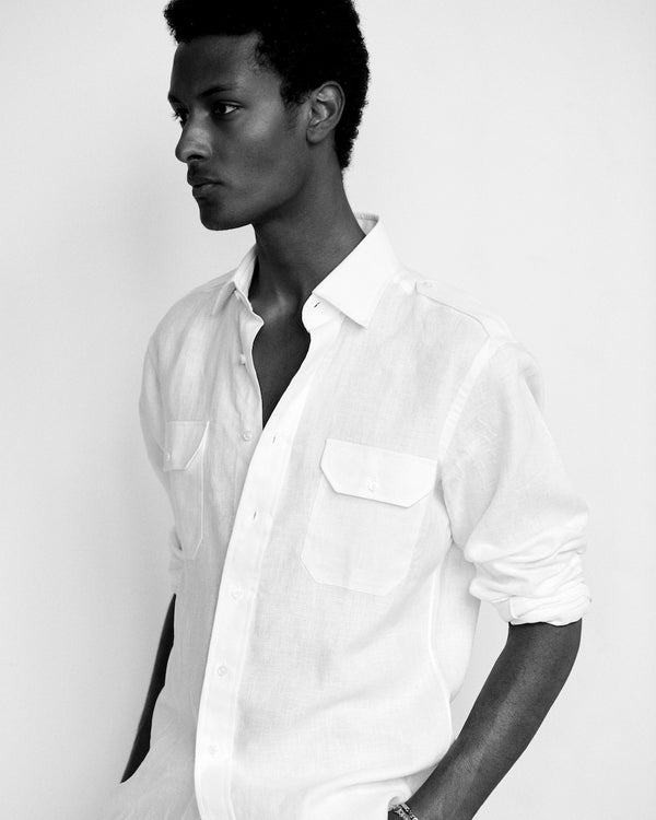 Male model wearing the Jonathan Mezibov white Linen Military Shirt.