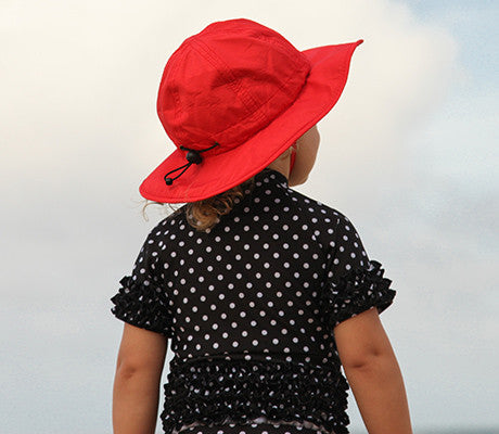 4d0ce144 Here you can see the SwimZip Sun Fun Play Hat in Red on an adorable little  girl! Our Sun Hats can be work for girls or boys!