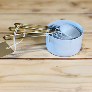 White with gold measuring cups