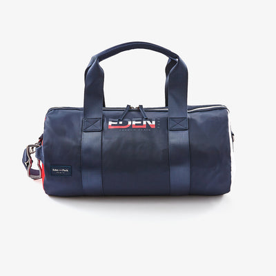 Navy blue and red canvas sports bag