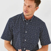 Navy blue short-sleeved shirt with palm tree micro-pattern