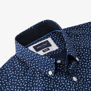 Navy blue short-sleeved shirt with white bow tie micro-pattern