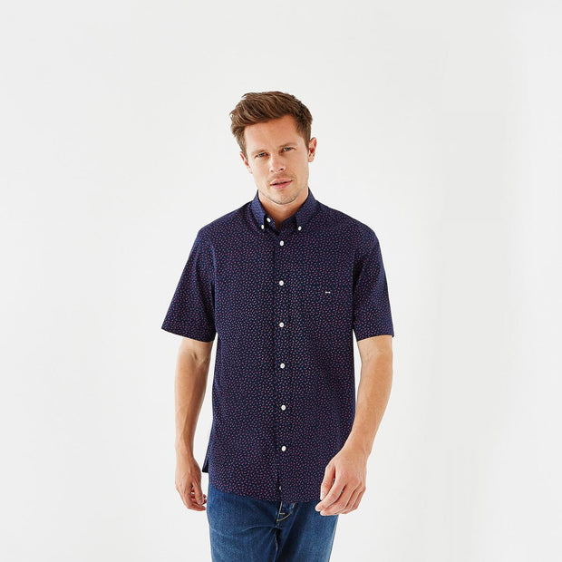 Navy blue short-sleeved shirt with pink bow tie micro-pattern