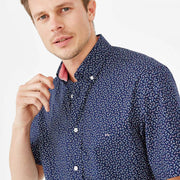 Navy blue short-sleeved shirt with tricolour bow tie pattern