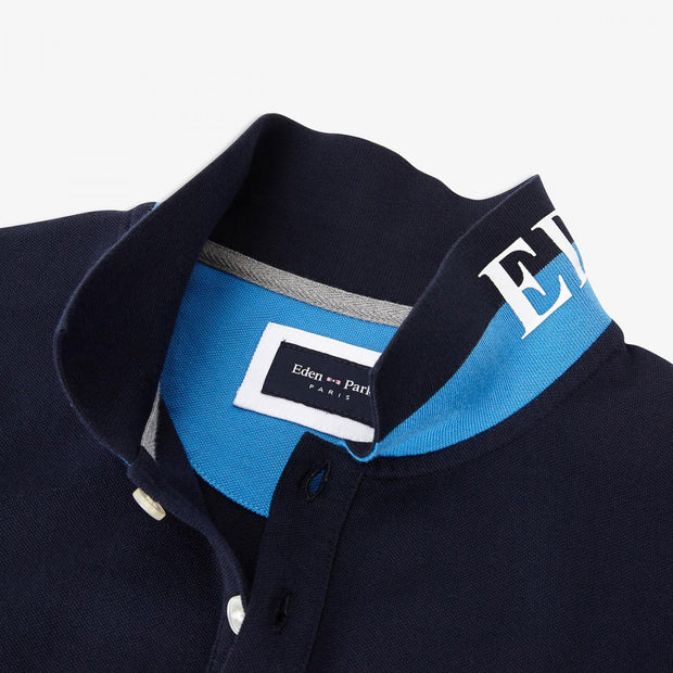 Blue polo with embroidered underside of collar