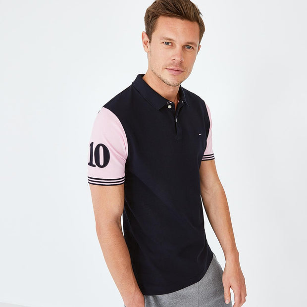 Navy blue cotton polo with contrasting pink sleeves