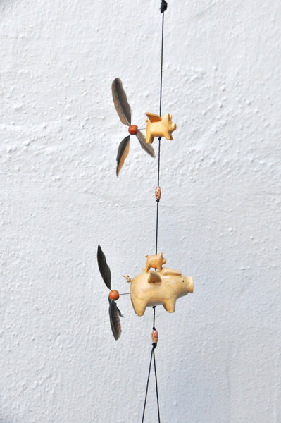 Flying Pig planter ,outdoor or indoor decor ,strong nylon string,  we are using Olympic stain,finished with varathane gloss,feather spinners that twirl in the wind