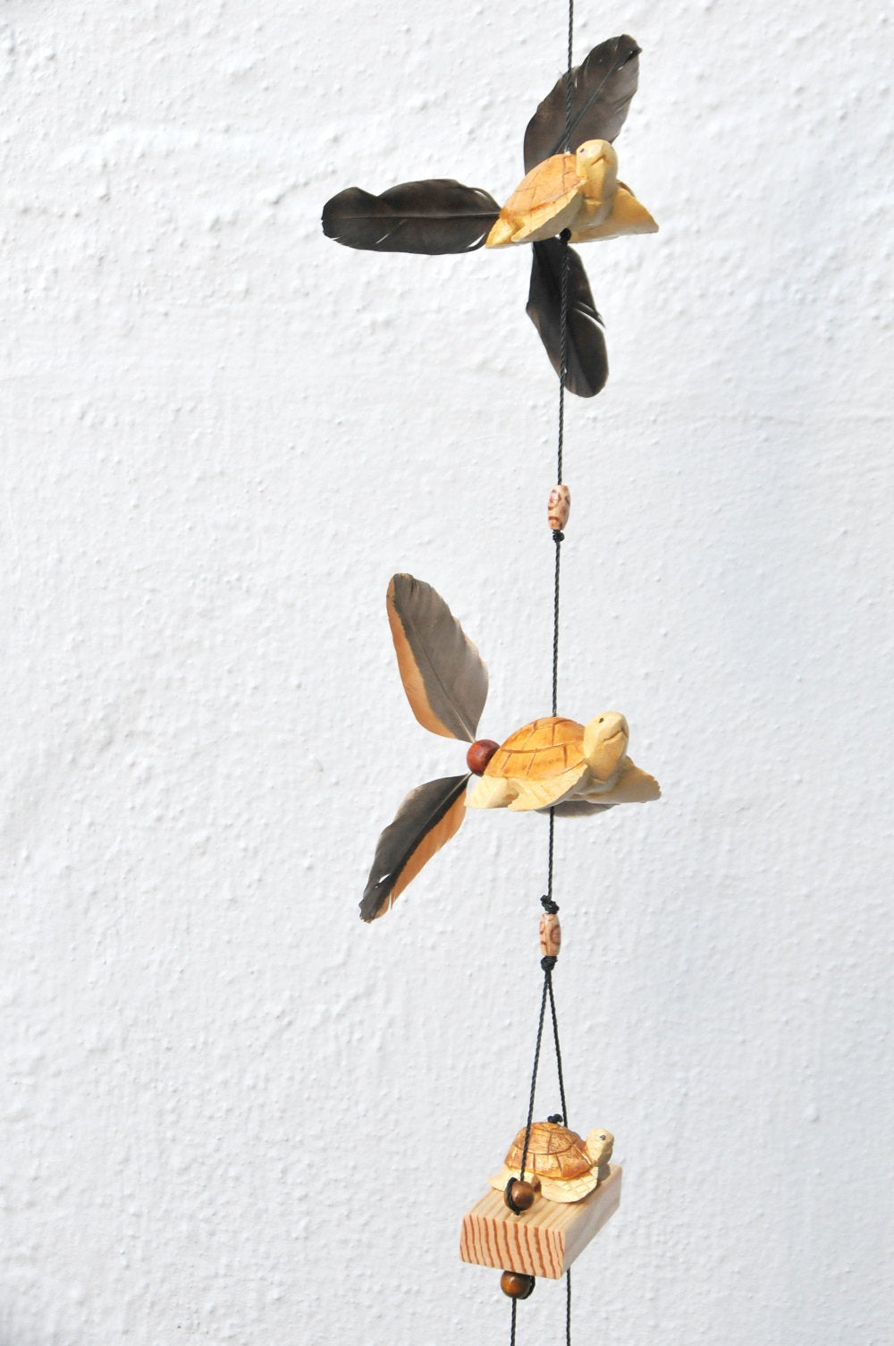 Wind chimes Turtles coconut shell pot,pinner feathers that twirl in the wind. Weather Proofed by using Olympic stain then finished with varathane gloss
