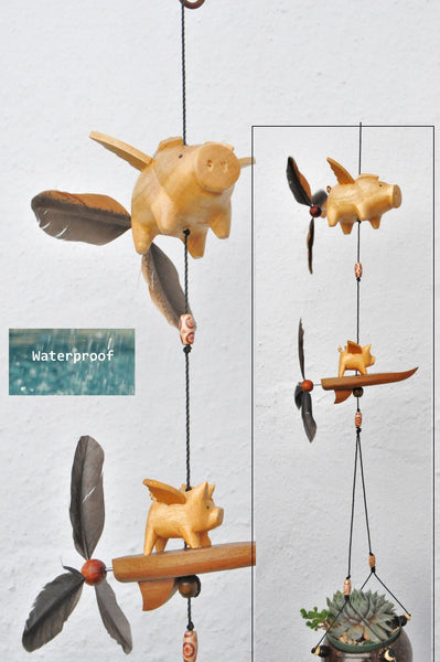 Surfboard flying Pigs ,Weatherproofed using ,feather spinners that twirl in the wind