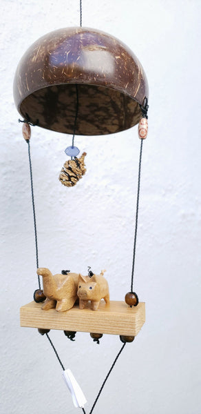 Outdoor wind chime elephants and pigs weatherproofed .with feather spinner .