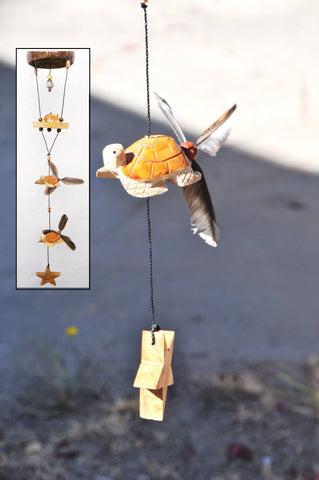 Turtle ,outdoor mobile with spinner feathers that twirl in the wind, also changeable.
