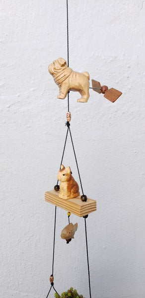 Outdoor wood craving cat,pug,fish .Weatherproof coconut pot planter.Removeable feather spinner.