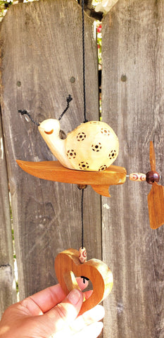 Wood craving Snail on surfboard weatherproof ,wind spinner,outdoor decoration .