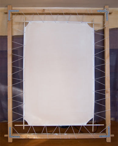Preparation for painting thangka on white cotton canvas