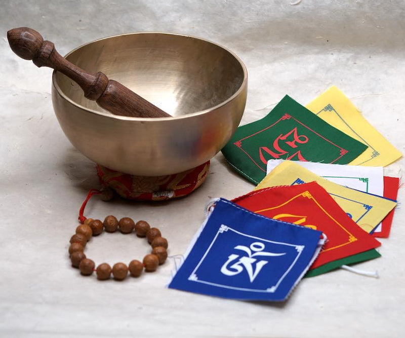 Himalayan singing bowl, prayer flag and bodhi seed bracelets for deep meditation, a perfect spiritual gift for father's day celebration.