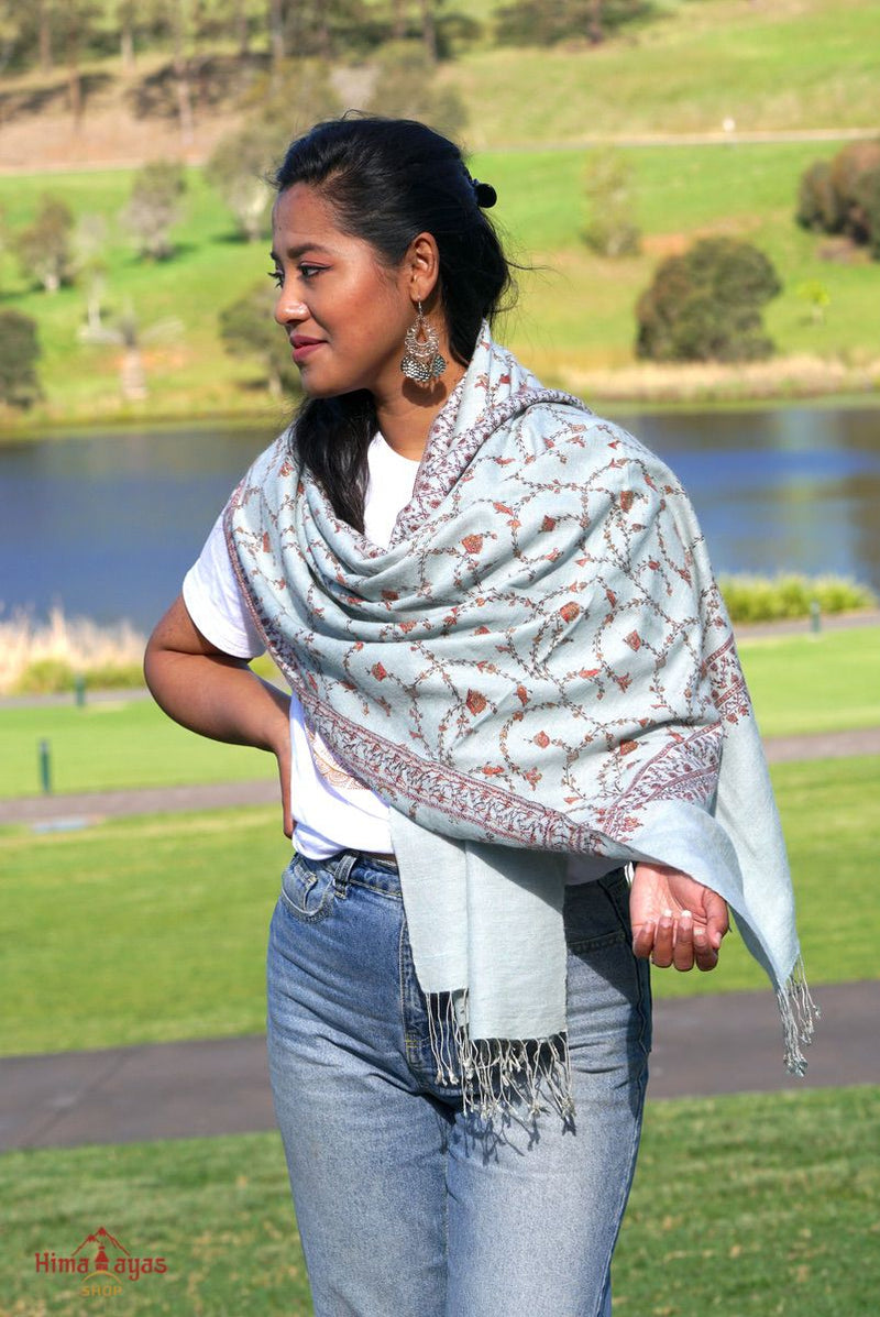 Sky blue pashmina shawl with light embroidery work for summer or spring wear.
