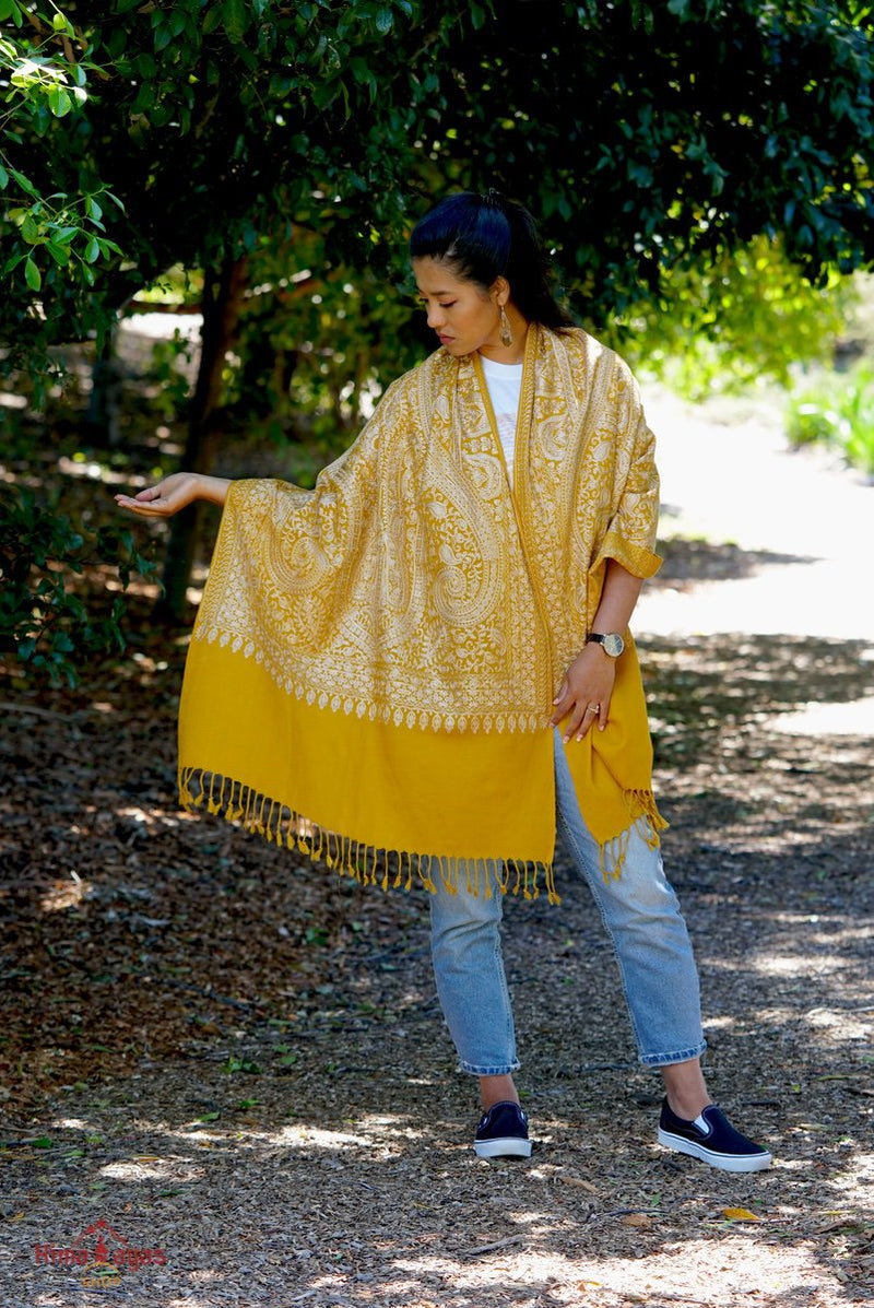 100% pashmina shawl with sunshine yellow and gold embroidery perfect for elegant looks. Ethically sourced and biodegradable material.