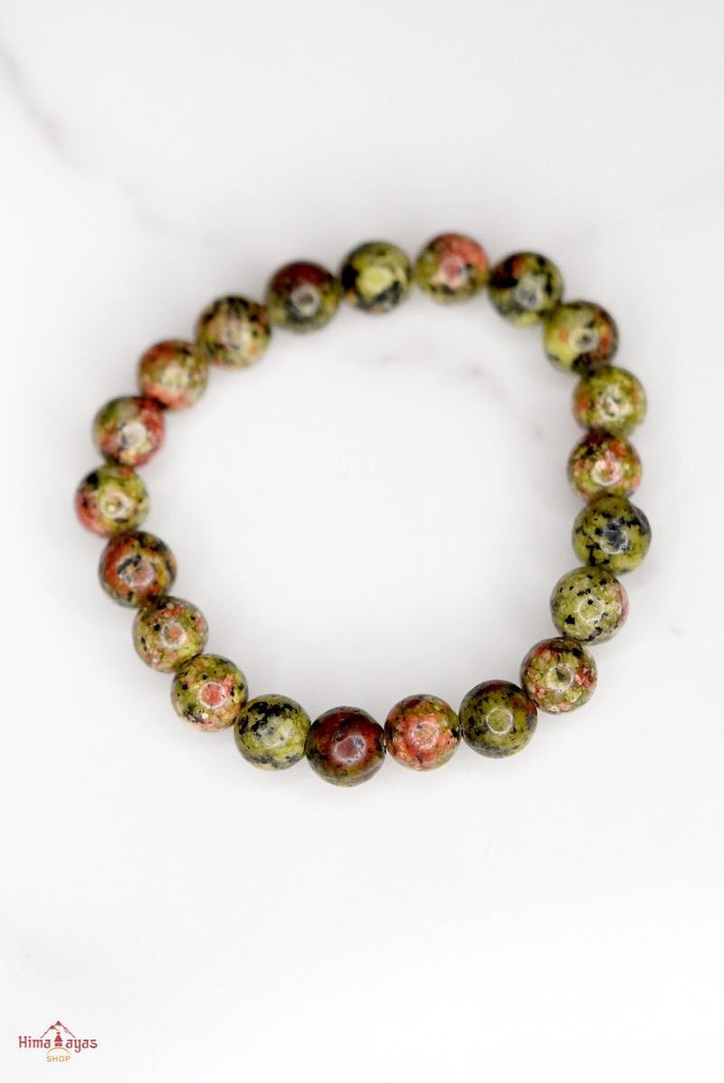 Unakite is said to be a stone of vision, opening the third eye and useful for scrying. It is also believed to be a stone of balance, grounding the self while bringing emotions and spirituality together.