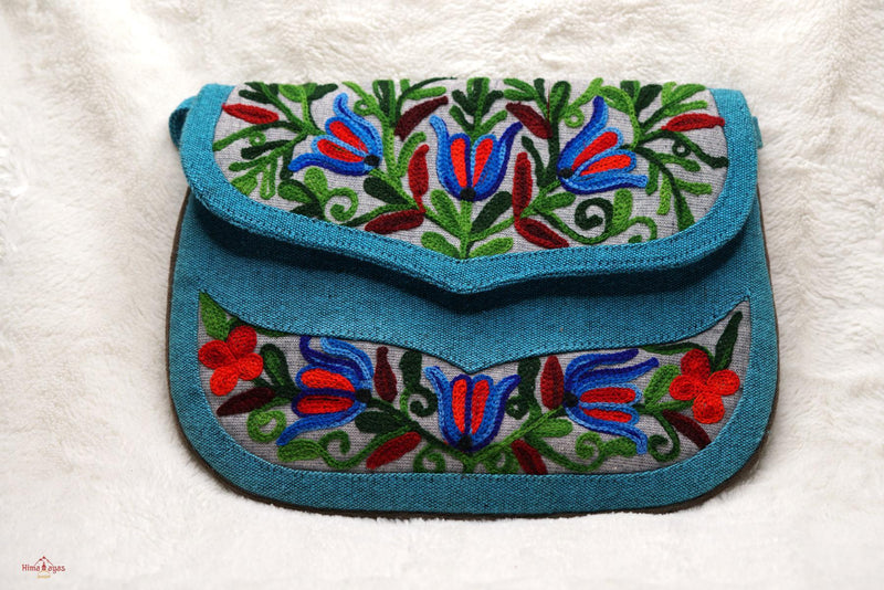 Beautiful handmade women's crossbody bag with floral embroidery design for chic style.