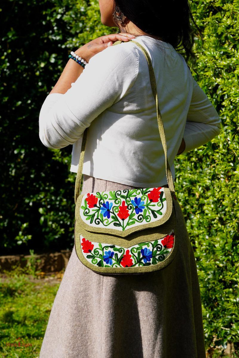 A classic women's hanmade bag, crafted with beautiful cashmere floral embroidery to give it a chic stylish look.