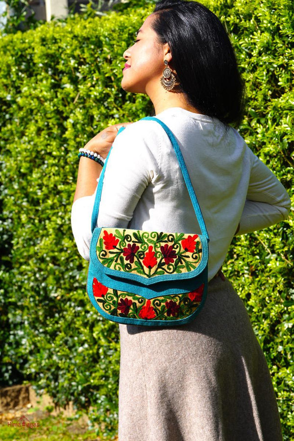 Beautiful handmade women's crossbody bag with floral embroidery design for chic boho style.