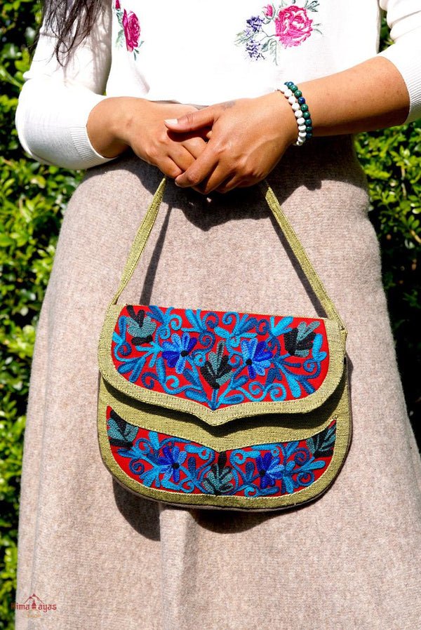 Beautiful hand embroidered crossbody bag with bright and multi-colour embroidered floral patterns.