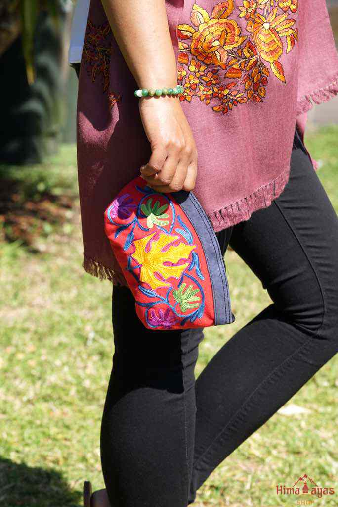 A special women pouch very light weight, ideal as a makeup bag or everyday use hand purse.