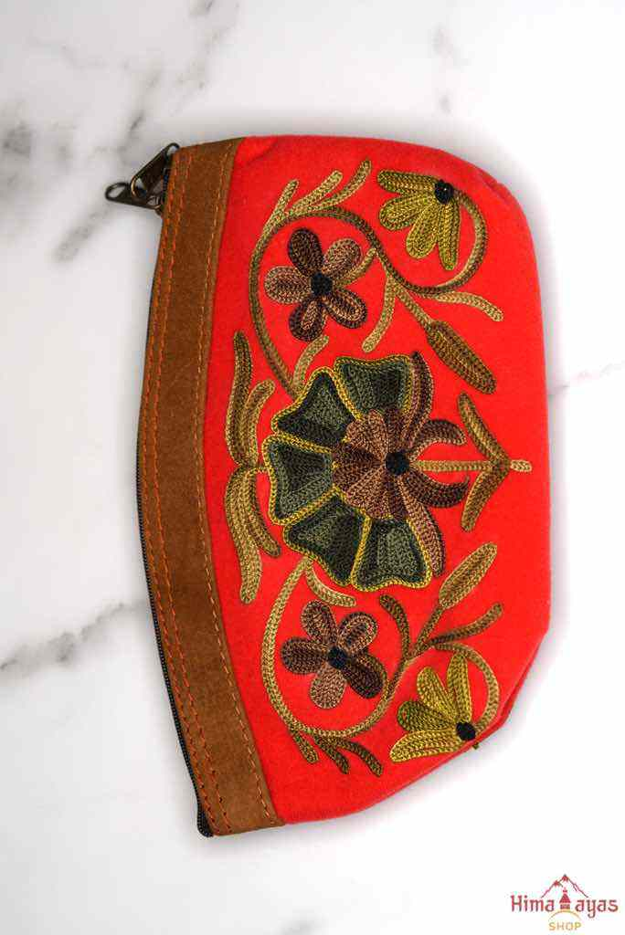 Women pouch purse with floral pattern, ultra-soft and lightweight. The pouch can be used as makeup bag or clutch that suit your style. Ethically made in Nepal.