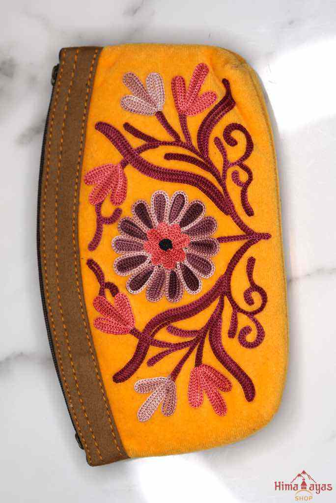 Beautiful Cashmere design women pouch made with hand-embroidery design with a very fine embellishment that involves elaborate and intricate floral motifs.