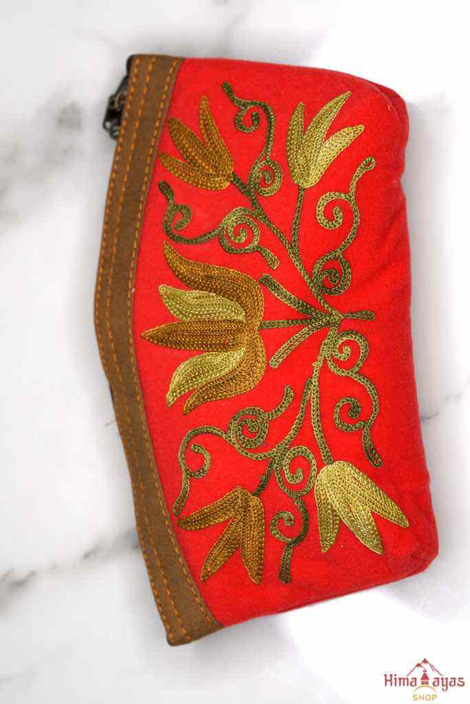 Beautiful Cashmere design pouch made with hand-embroidery design with a very fine embellishment that involves elaborate and intricate floral motifs.