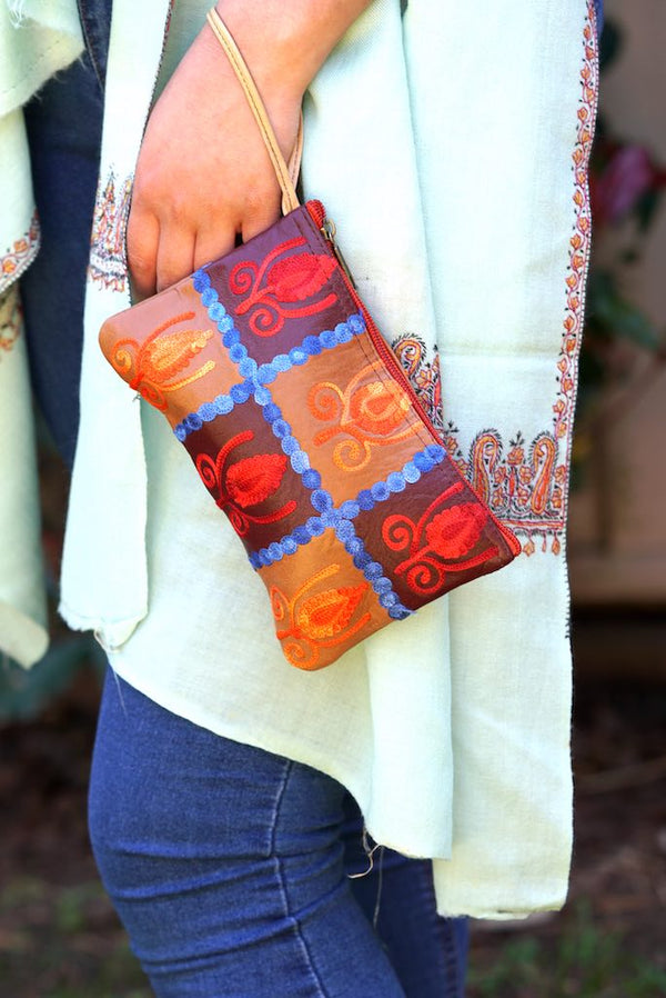 Vibrant colorful purse with kashmiri hand embroidery, has a secure zip top closure, ethically made in Nepal.