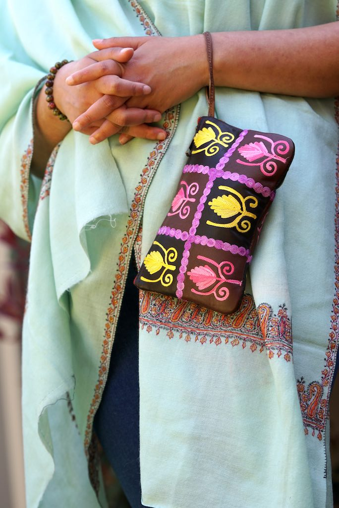 Vibrant colorful purse with kashmiri hand embroidery, has a secure zip top closure, ethically made in Nepal.Vibrant colorful purse with kashmiri hand embroidery, has a secure zip top closure, ethically made in Nepal.