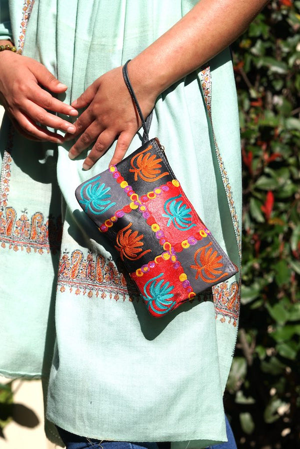 A stylist wristlet women purse for everyday use, handmade and kashmiri embroidery design for boho style.