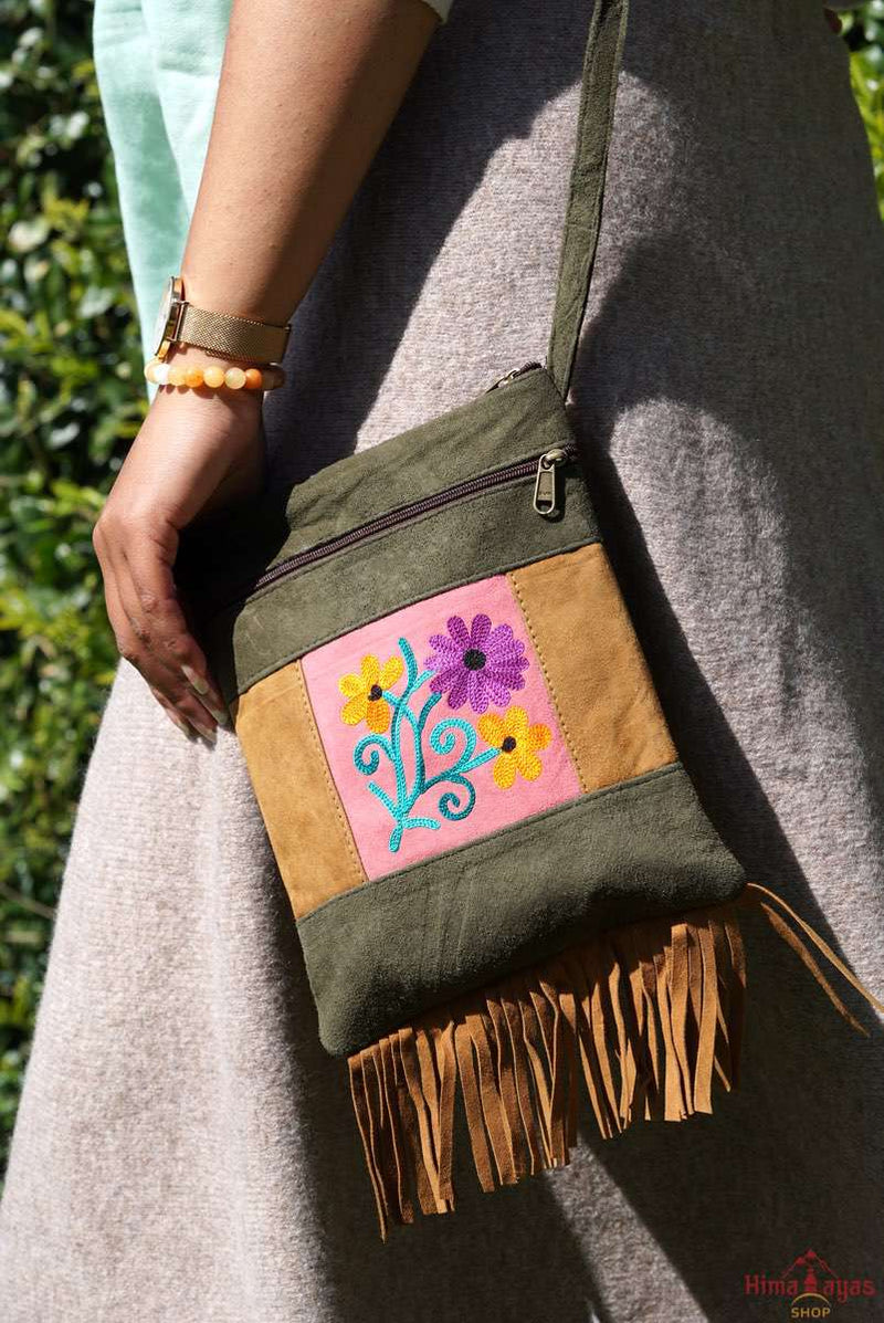 Easy to carry side bag for women, features a beautiful hand embroidered floral pattern.