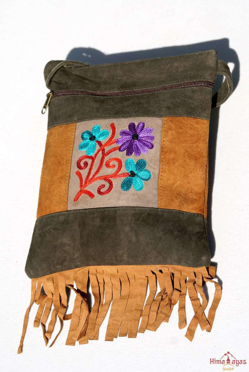 A unique style women's sling bag, crafted with beautiful cashmere floral embroidery to give it a chic stylish look.