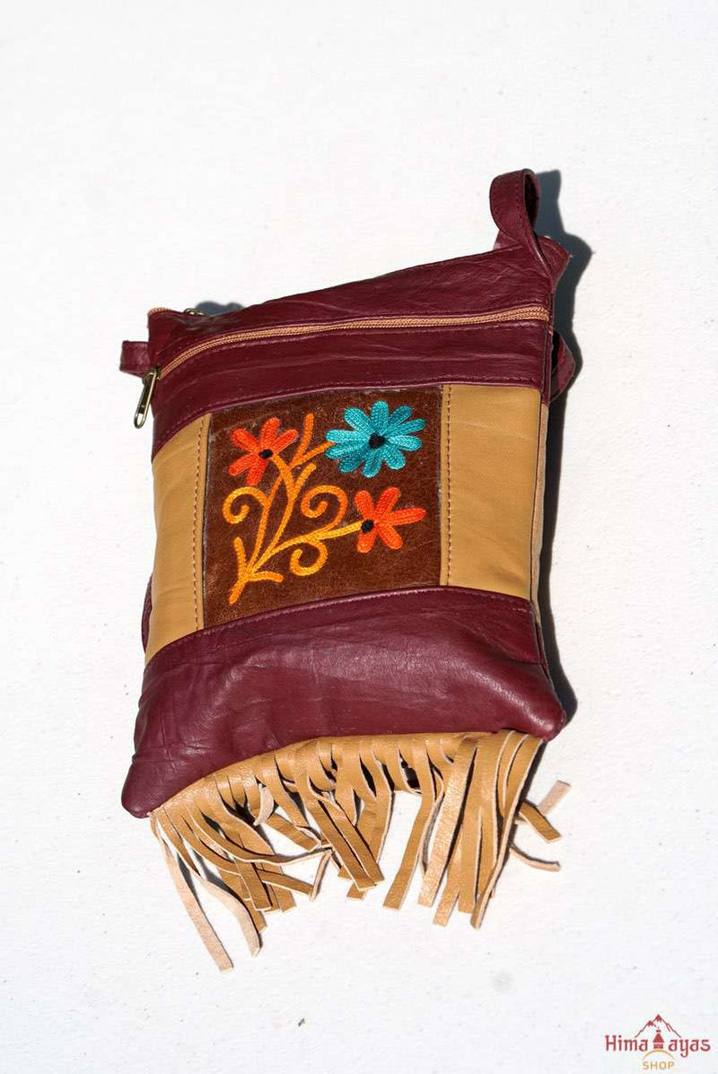 A unique style women's crossbody bag with fringe, crafted ethically from Himalayas.