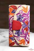 A beautiful floral pattern cardholder wallet which features intricate hand embroidery design and plenty of interior space for everyday use.