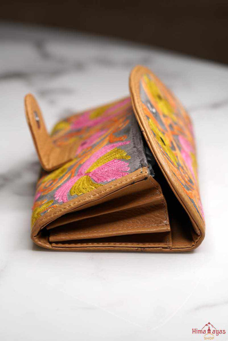 This stunning piece of handcrafted wallet is specially designed with Kashmiri style hand-embroidery, perfect for everyday use,