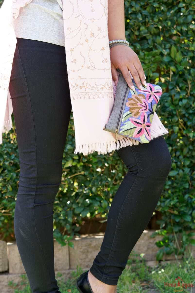A stylish yet convenient hand woven wristlet purse with beautiful floral pattern, It has a secure zip top closure and two extra compartments for your everyday essentials making it easy to travel simple and light.